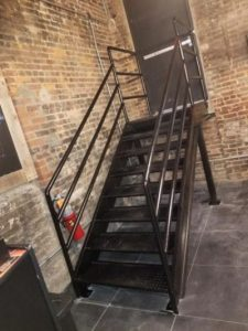 diamond plate iron steel stairs with piperails