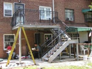 galvanized open tread metal staircase and deck porch